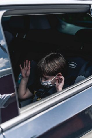 A child alone in a car unsupervised.